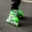 person wearing pair of green inline skates